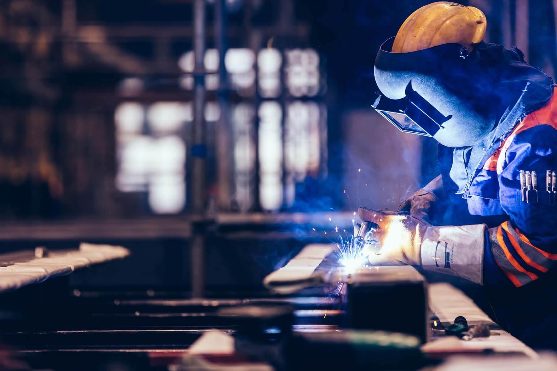 worker-welding-in-a-factory-CAK7CQ8-1.jpg